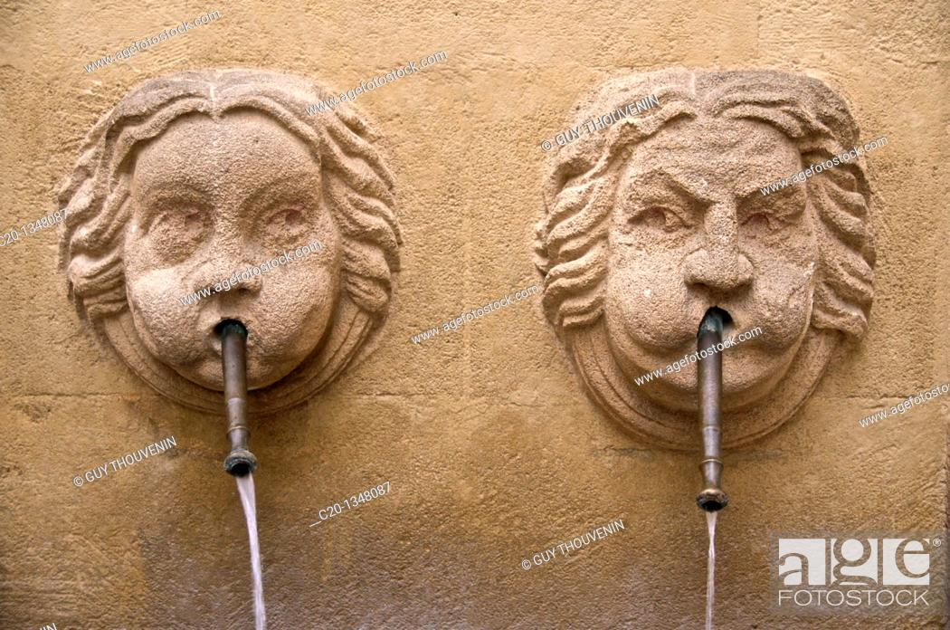 Stock Photo: Bagniers Fountain with 2 faces Old Aix Aix en Provence 13 France.