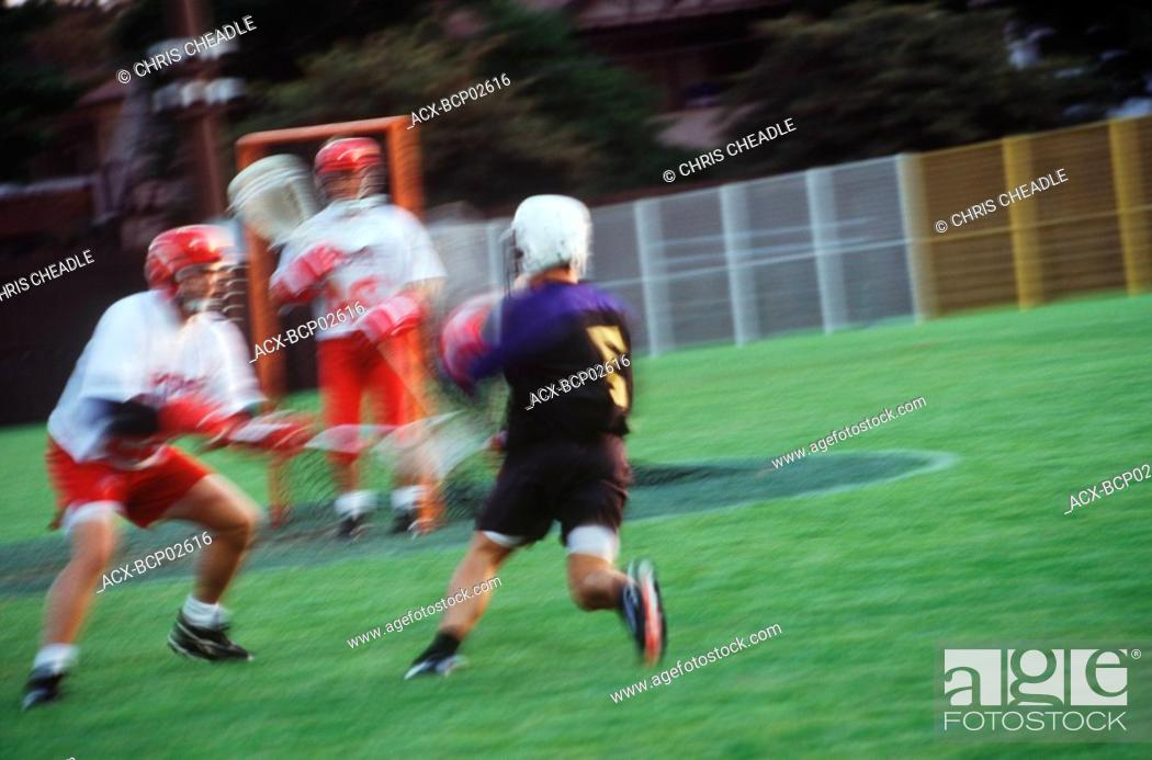 Stock Photo: Field lacrosse players in motion blur, British Columbia, Canada.