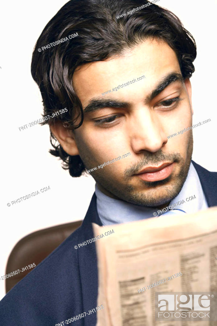 Stock Photo: Close-up of a businessman reading a newspaper.