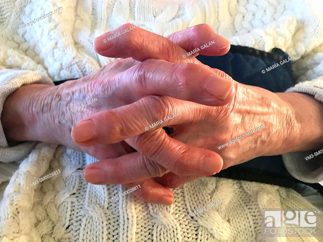 Stock Photo: Old woman's interlaced hands. Close view.