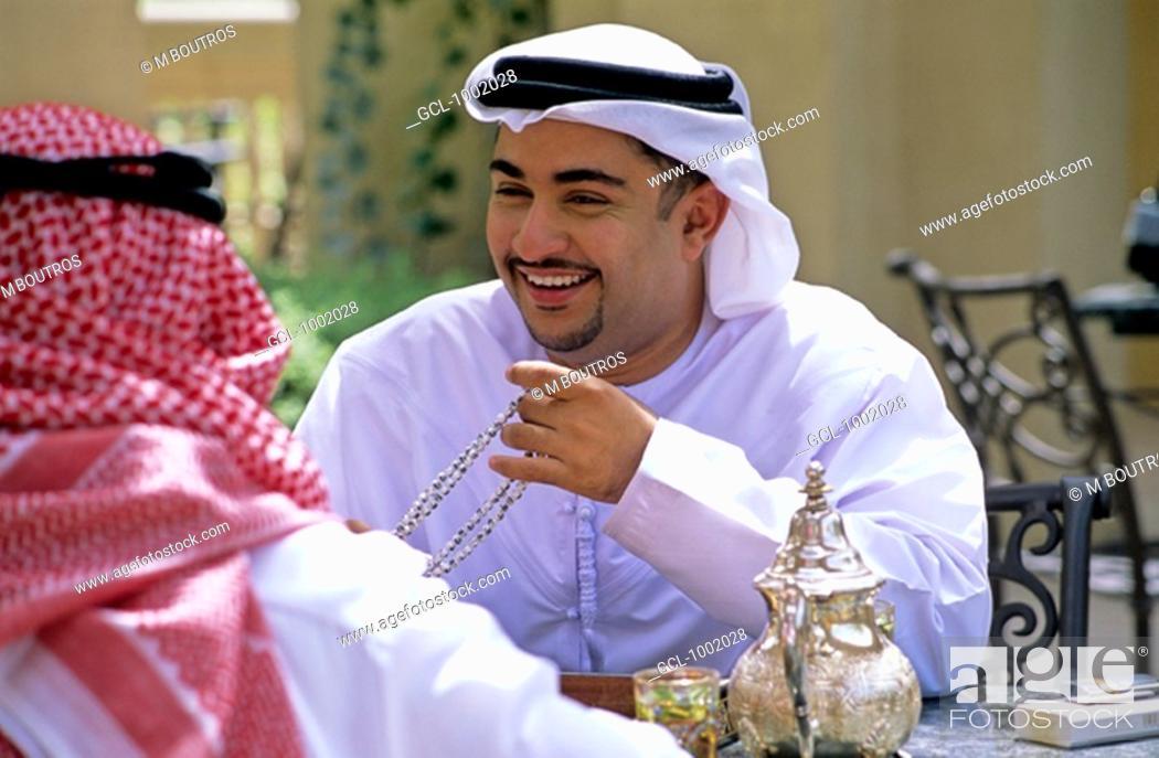 Stock Photo: Arab men enjoying tea and backgammon.