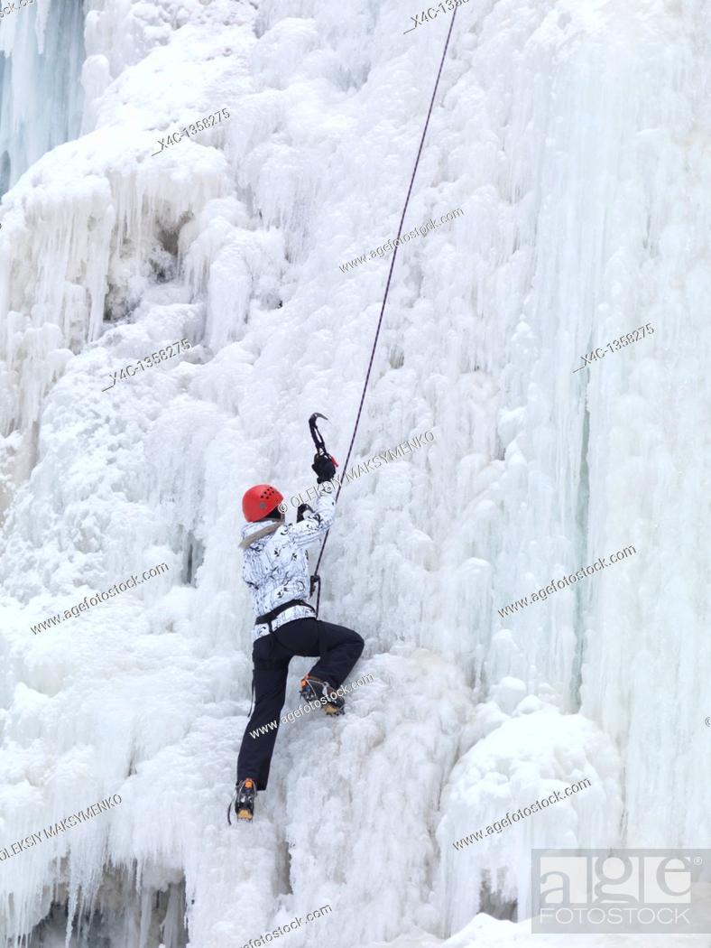 Stock Photo: Ice climber climbing a frozen waterfall  Wintertime scenic, Ontario, Canada.