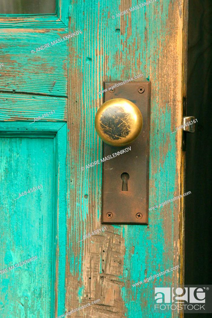 Stock Photo: Door knob on wooden door.
