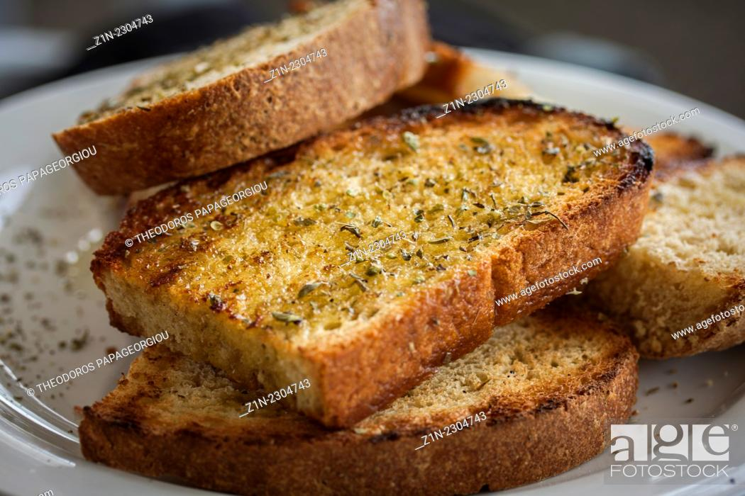 Stock Photo: Grilled bread with olive oil and origano in a restaurant at Poulithra village. Arcadia, Peloponnese, Greece.