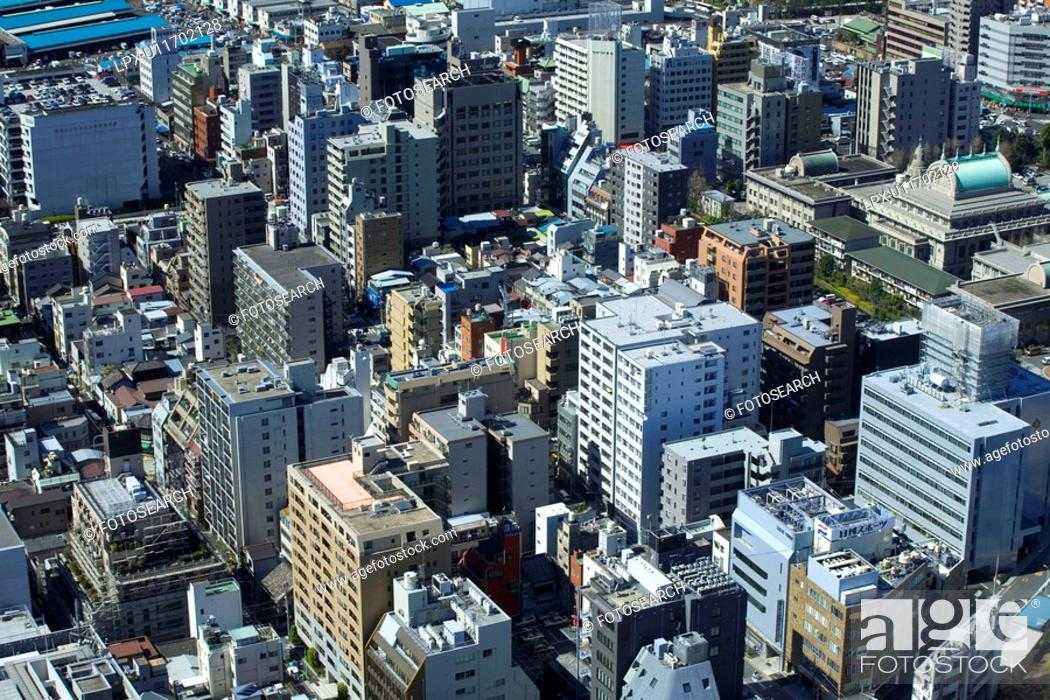 Stock Photo: Street lined with large buildings.