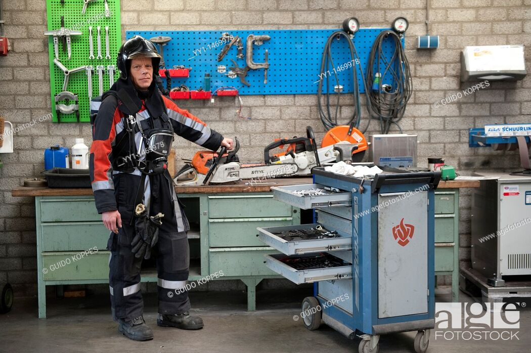 Stock Photo: Firefighter in fireproof turnout gear on his regular job in the barracks.