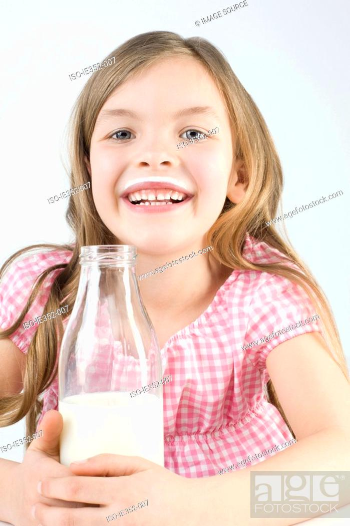 Stock Photo: Girl with bottle of milk.