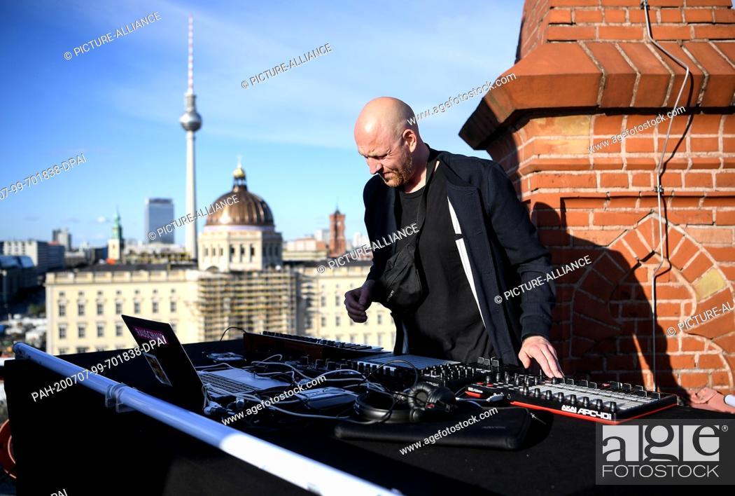 "Stock Photo: 06 July 2020, Berlin: DJ Moritz Rausch aka Rauschhaus at the soundcheck on the roof of the Friedrichswerder Church as part of the project """"SPOT / berlin art."