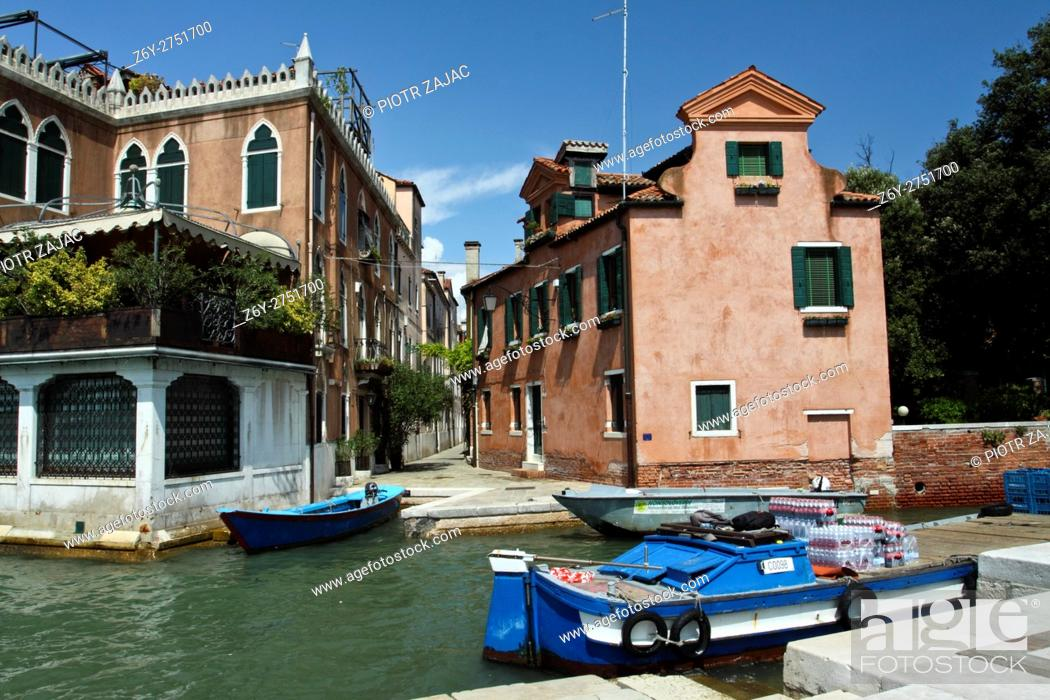Stock Photo: Boat loaded with drinks for local store moored in Venice, Italy.