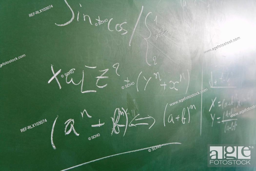 Stock Photo: Mathematical formula written on green blackboard in classroom, close-up.