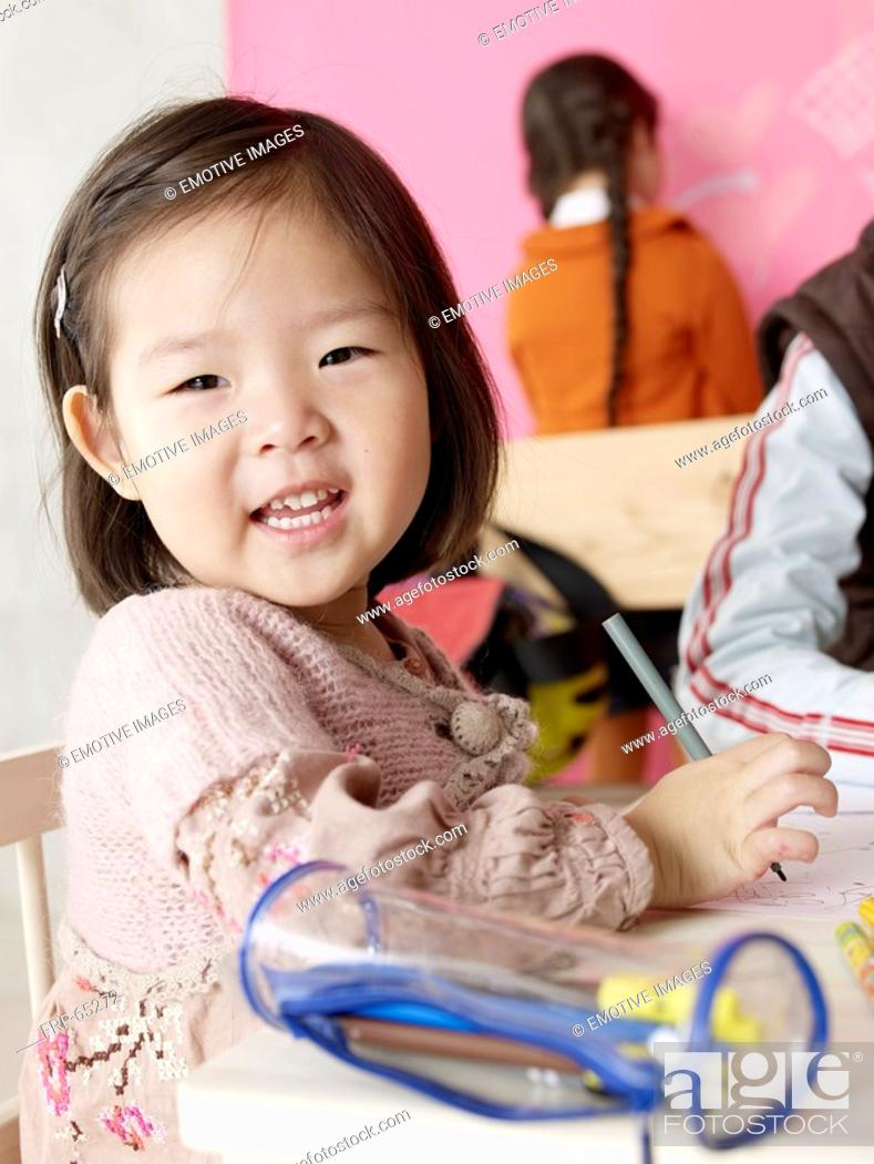 Stock Photo: Asian girl with pencil case.