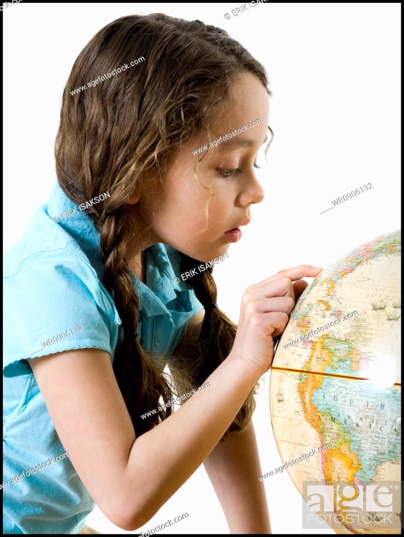 Stock Photo: Profile of a girl looking at a globe.