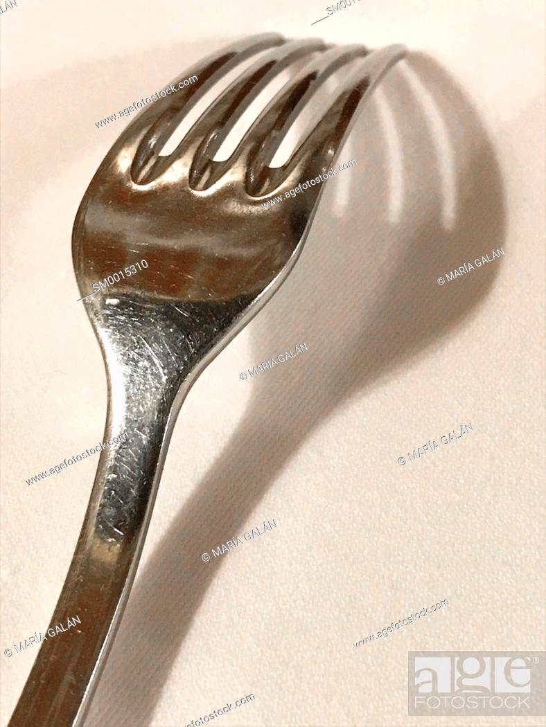 Stock Photo: Fork and its shadow.