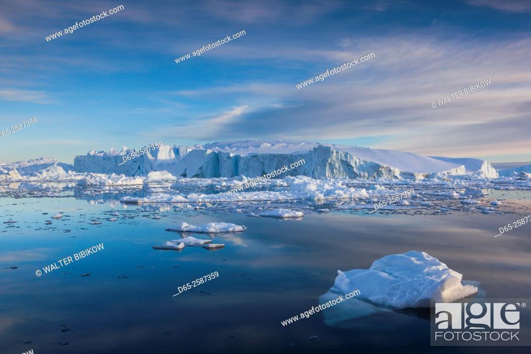 Stock Photo: Greenland, Disko Bay, Ilulissat, floating ice at sunset.