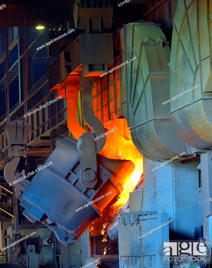 Stock Photo: hot molten steel in a iron and steel plant production.