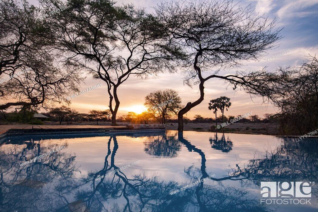 Stock Photo: Sunset Reflections at Onguma Tented Camp, Onguma Game Reserve, Namibia, Africa.