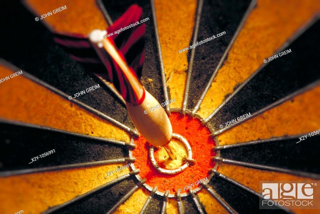 Stock Photo: Dart in bulls eye of a dart board.
