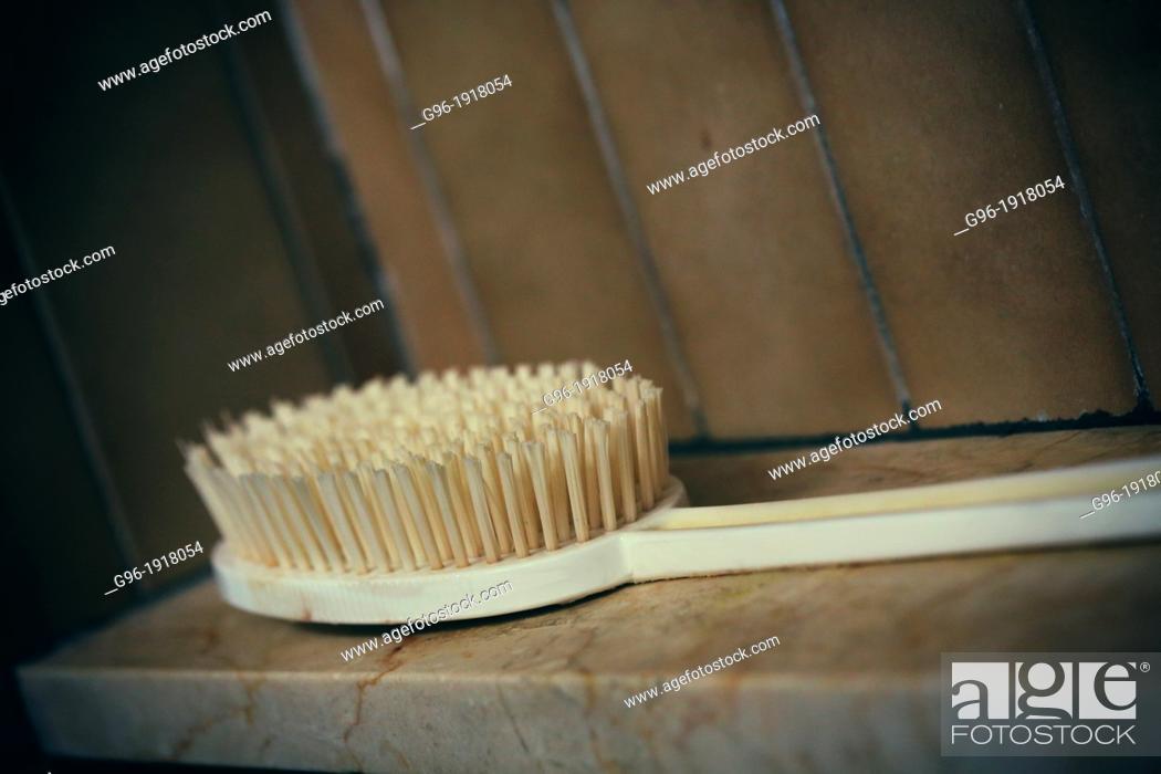 Stock Photo: Brush and bathub.