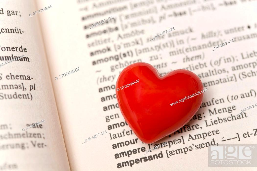 Stock Photo: Red heart in a dictionary.