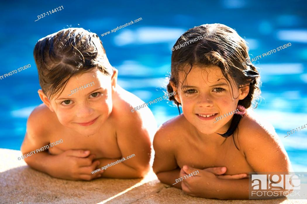 Stock Photo: Two caucasian girls in the swimming pool.