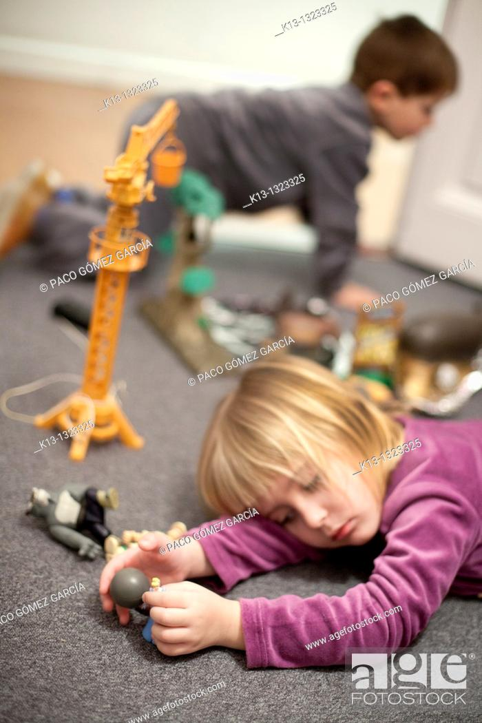 Stock Photo: children playing at home.