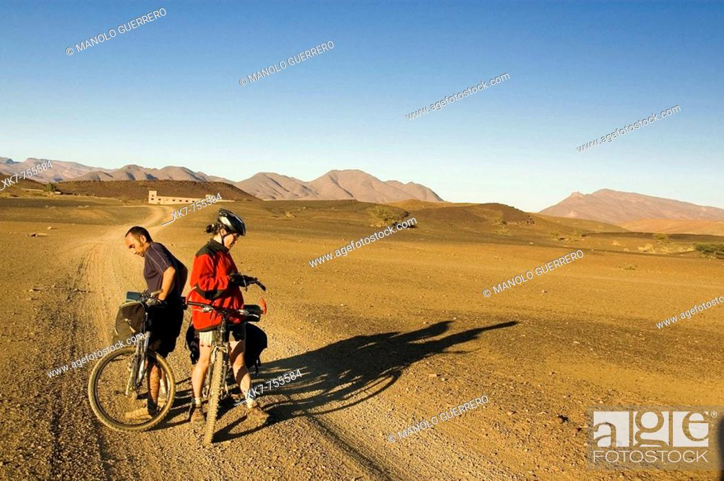 Stock Photo: Couple taking a break during their journey through Draa Valley, South Morocco (between Ouarzazate and Zagora).