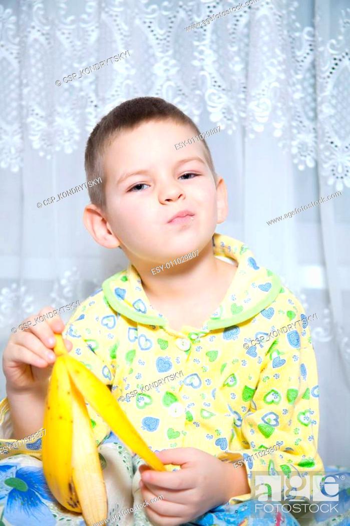 Stock Photo: Boy eats a banana.