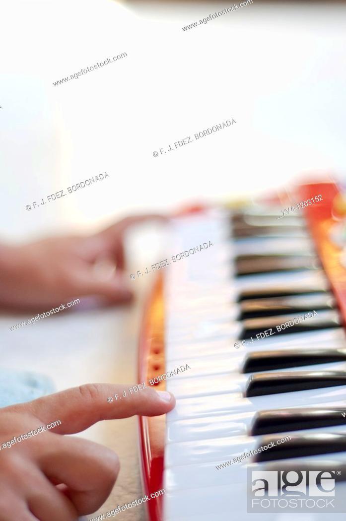 Stock Photo: Hand boy playing electronic piano.
