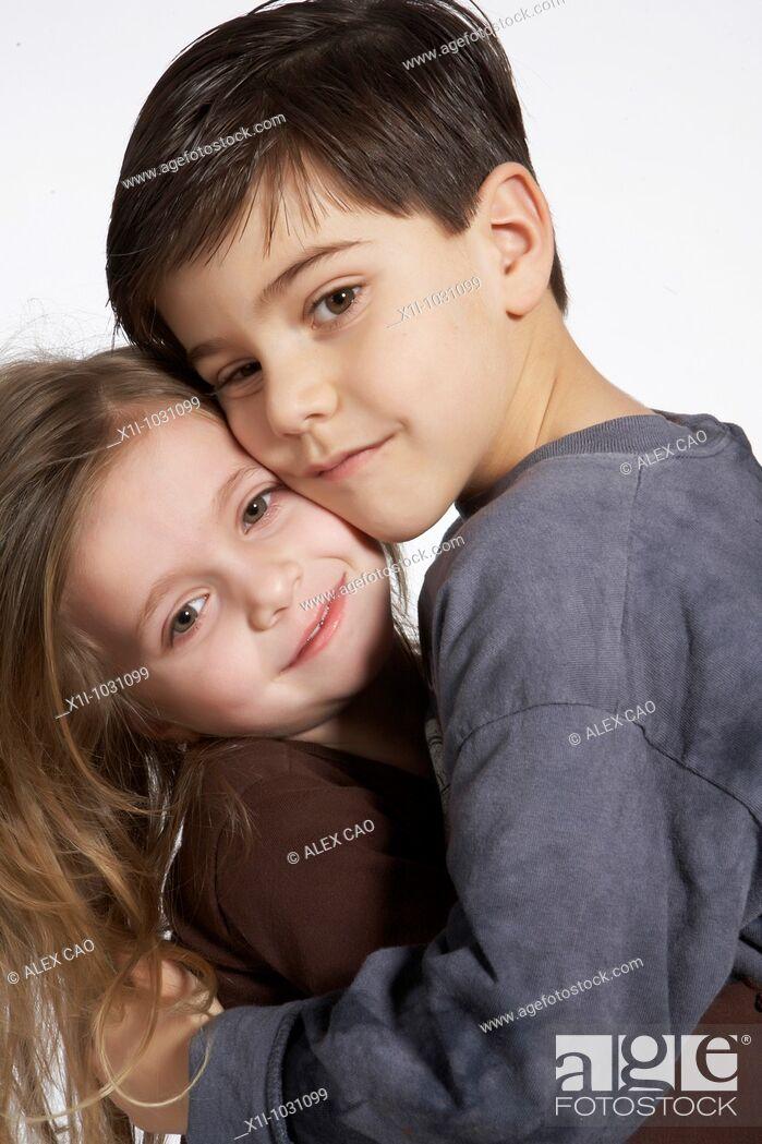 Stock Photo: Older Brother Hugging Little Sister.