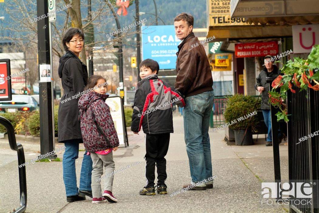 Stock Photo: A family of four in North Vancouver, BC, Canada.