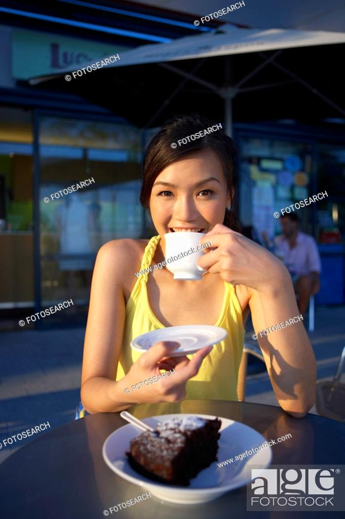 Stock Photo: Young Lady Sitting Outdoor Cafe, Holding Cup, Smiling.