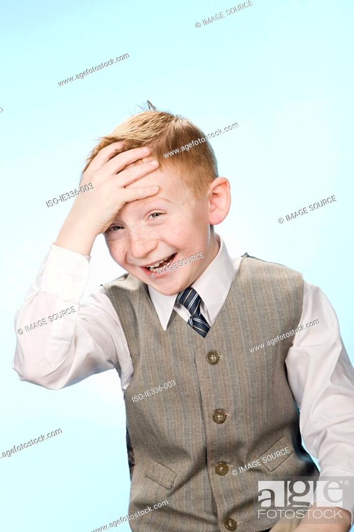 Stock Photo: Portrait of a boy laughing.