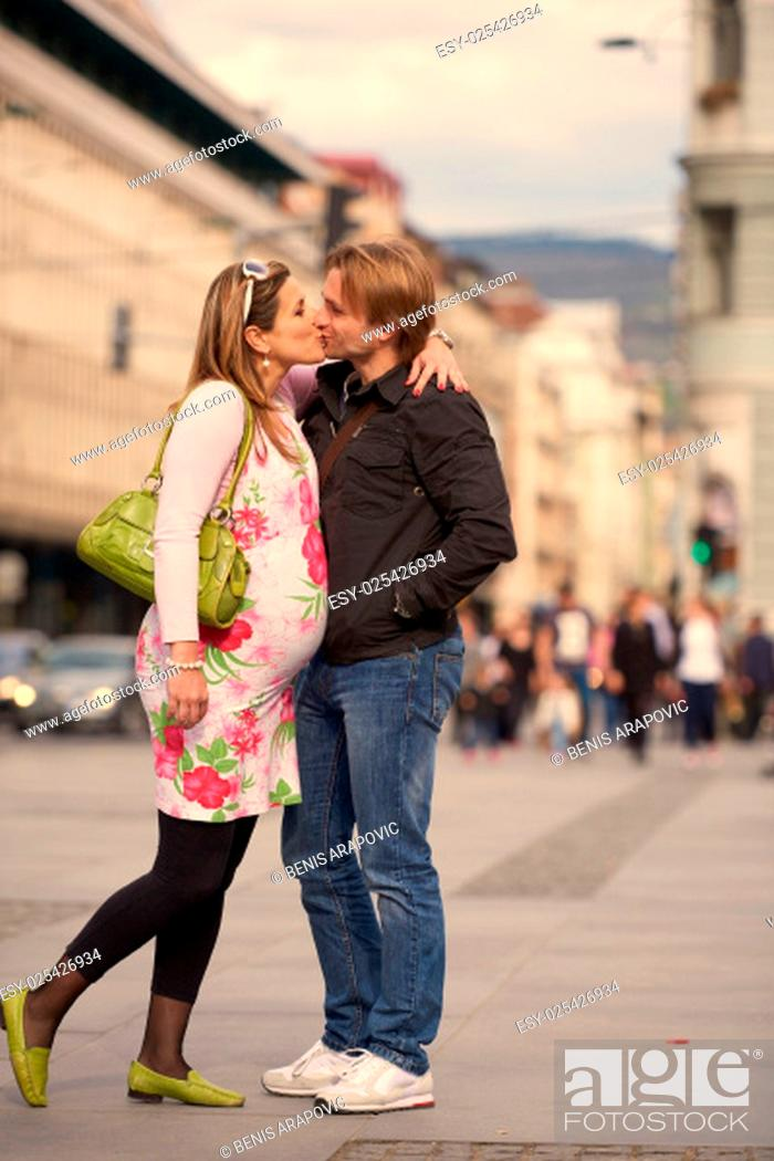 Stock Photo: Happy and young pregnant couple have fun and relax outdoor.
