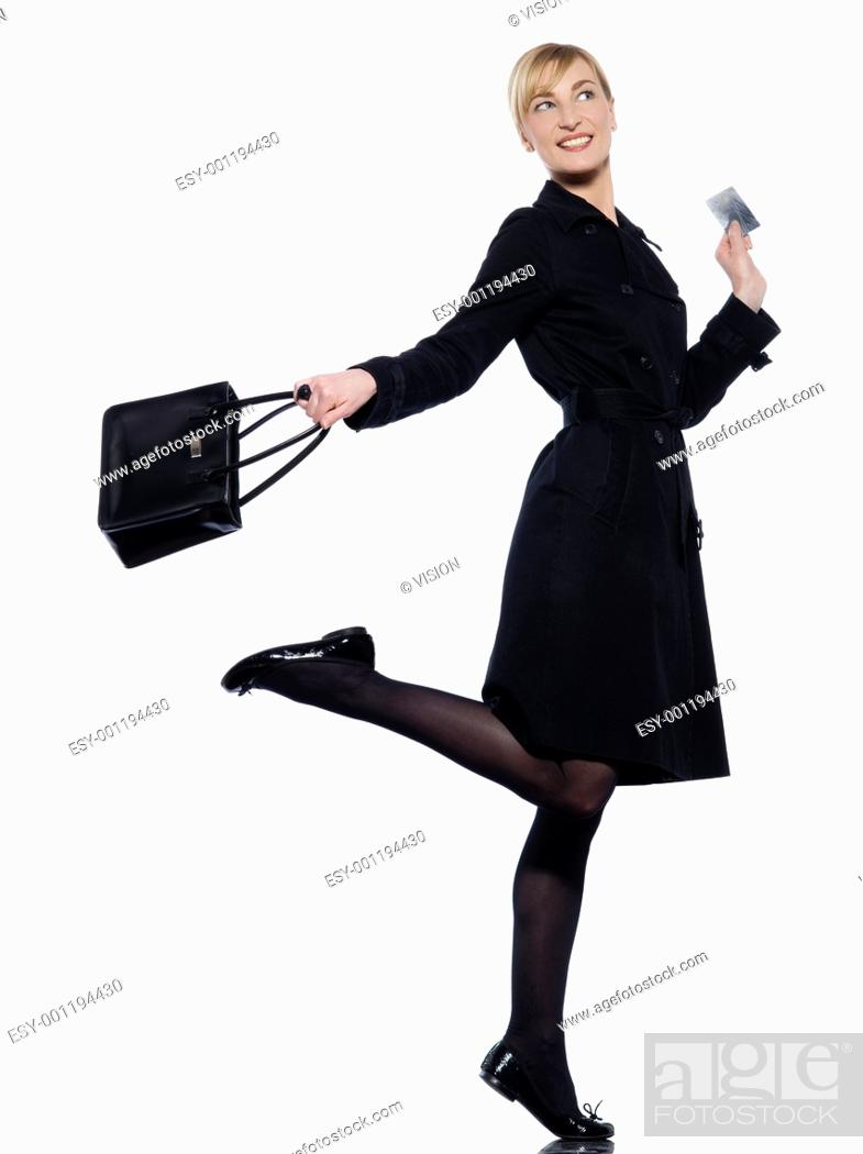 Stock Photo: beautiful woman on studio white background hoding a credit card.