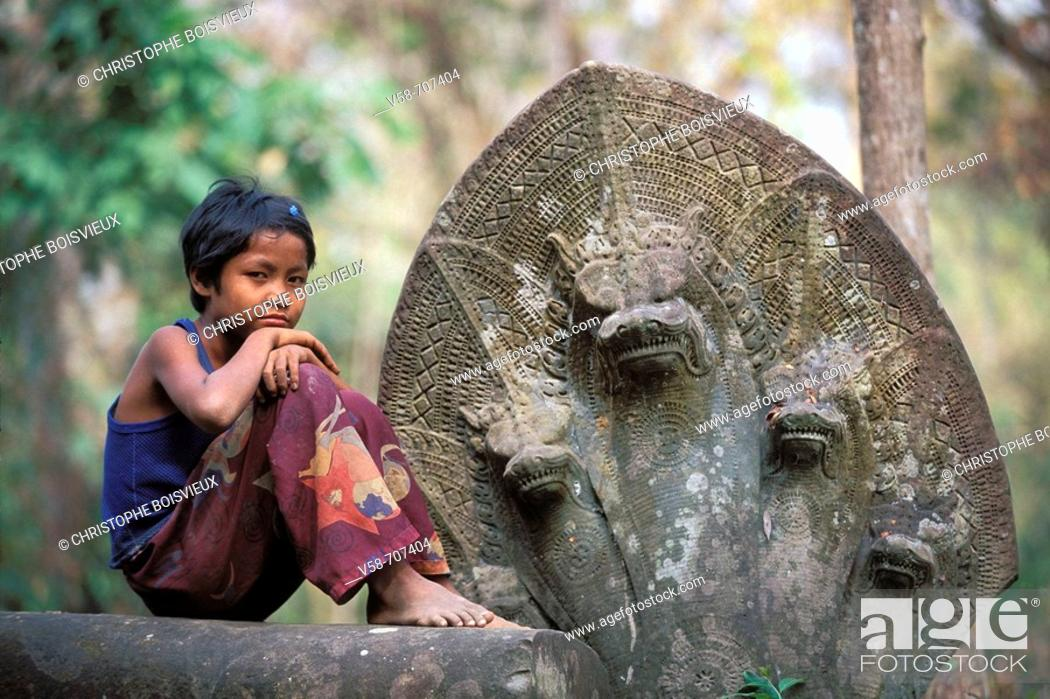 Stock Photo: CHILD AND NAGAS, BENG MEALEA TEMPLE XIITH CENTURY, ANGKOR REGION, CAMBODIA.