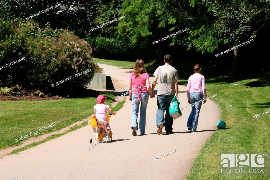 Stock Photo: Family walk in the park.