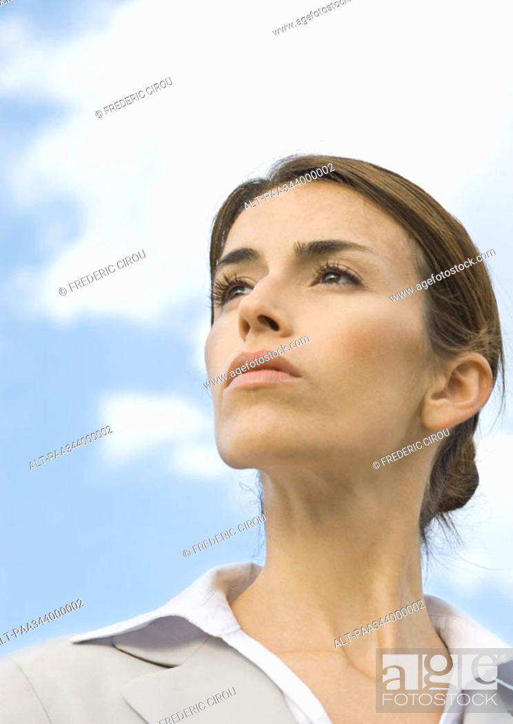 Stock Photo: Woman looking into distance, portrait, low angle view.