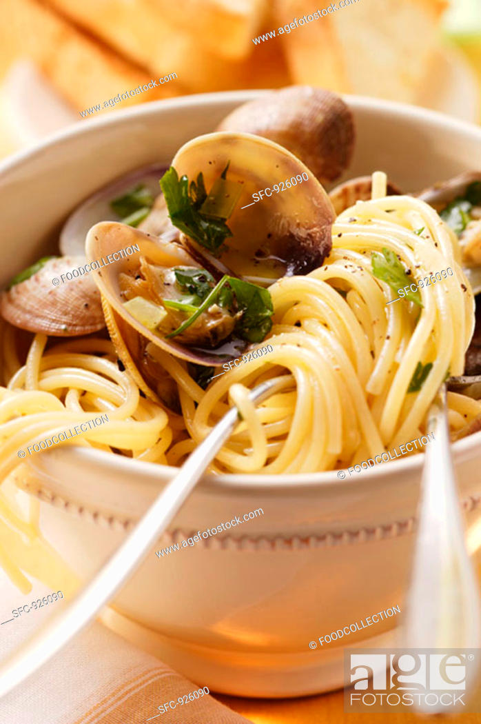 Stock Photo: Spaghetti vongole with herbs.