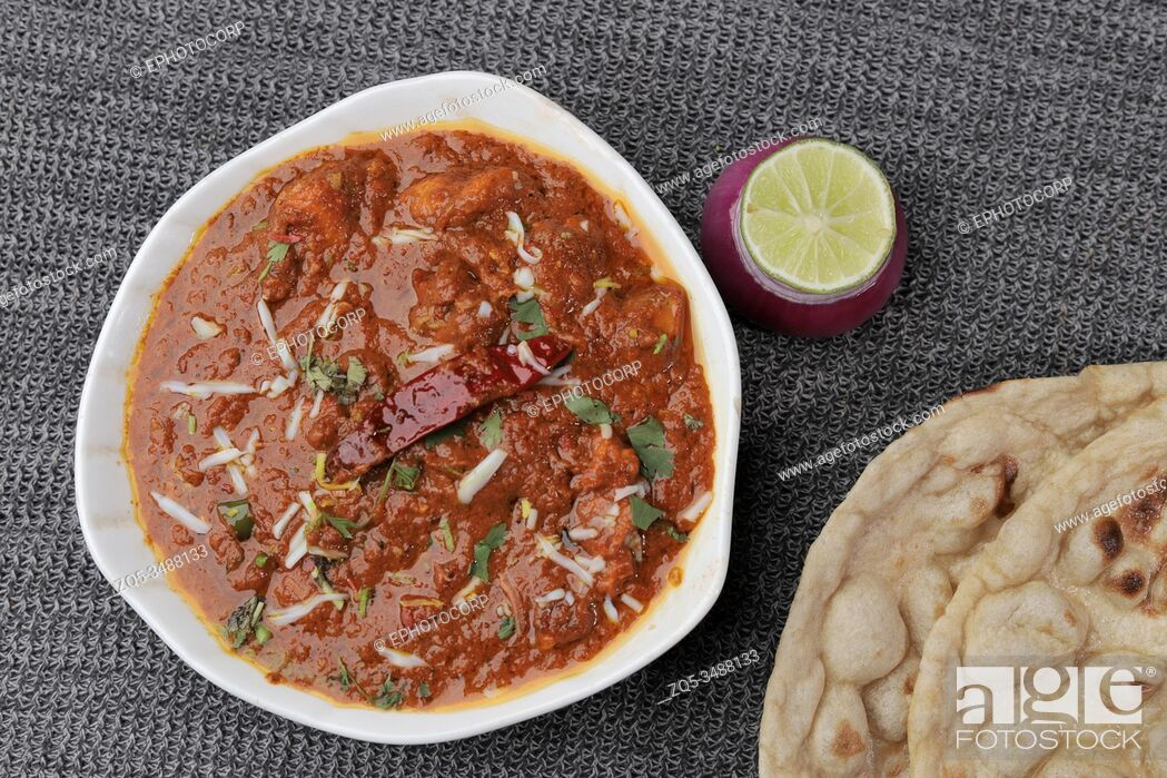 Stock Photo: Chicken curry served with roti or Indian bread.