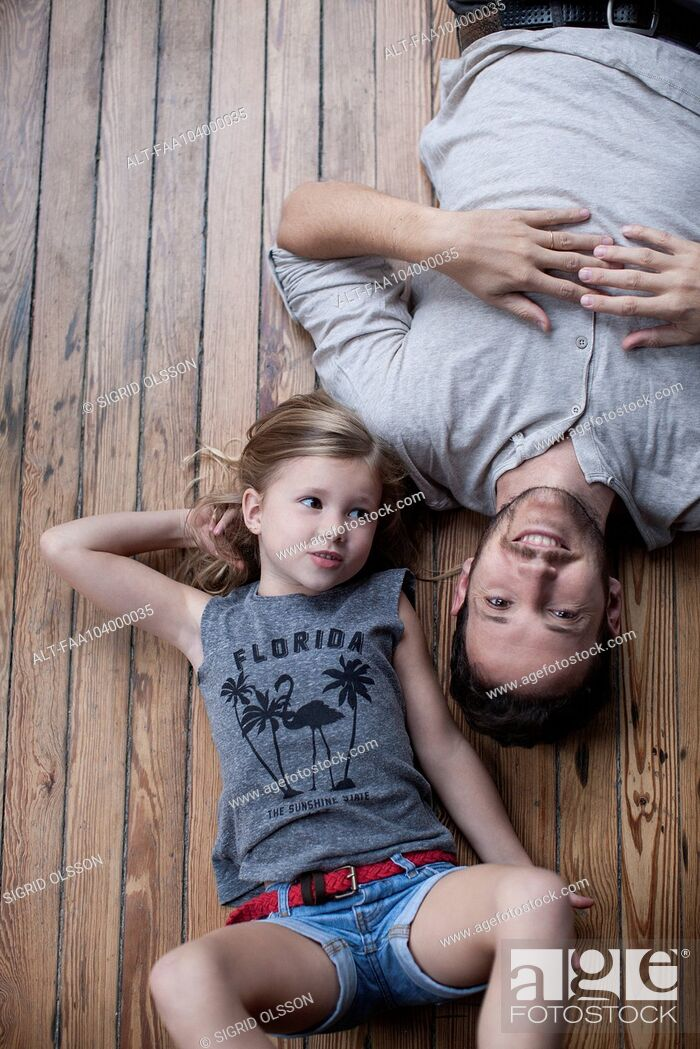 Stock Photo: Little girl and father hanging out together.