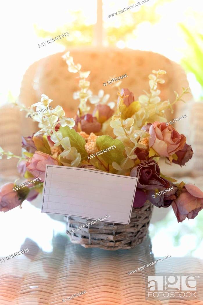 Stock Photo: white paper blank on flowers vase decorated in living room.