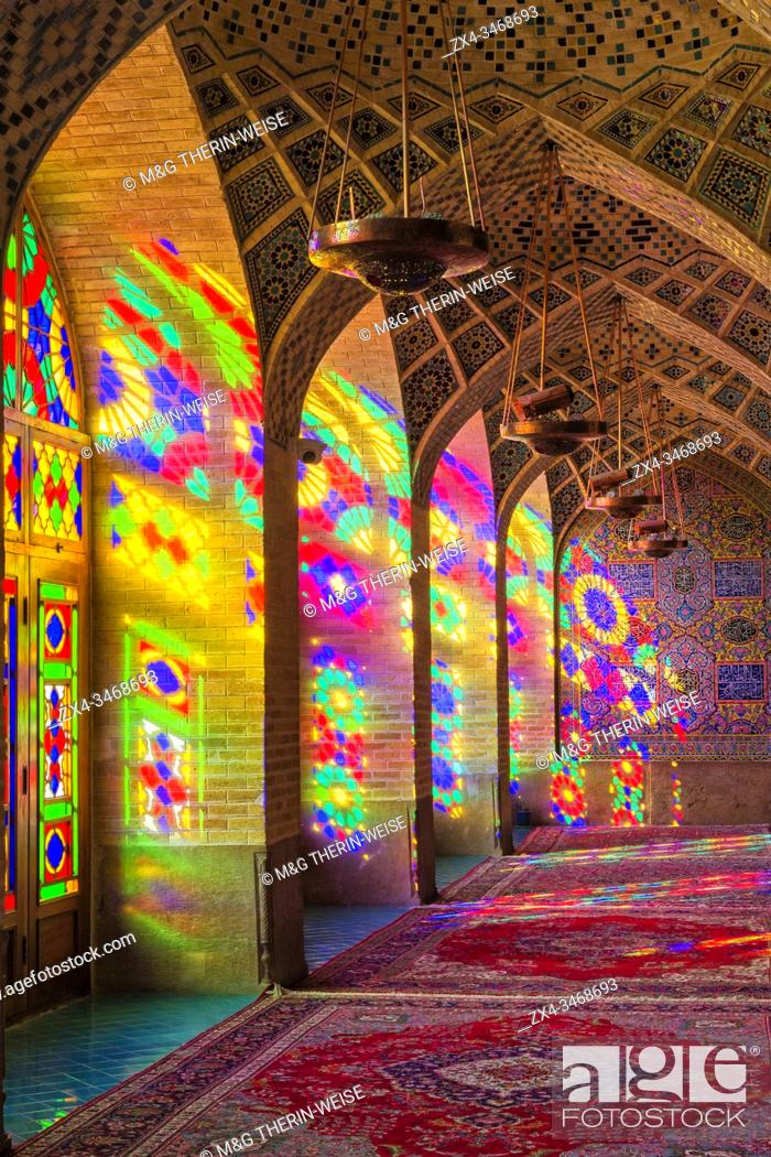 Stock Photo: Nasir-ol-Molk Mosque or Pink Mosque, Light patterns from colored stained glass illuminating the iwan, Shiraz, Fars Province, Iran, Asia.
