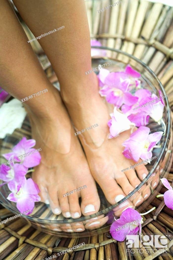 Stock Photo: Woman with feet in bowl.