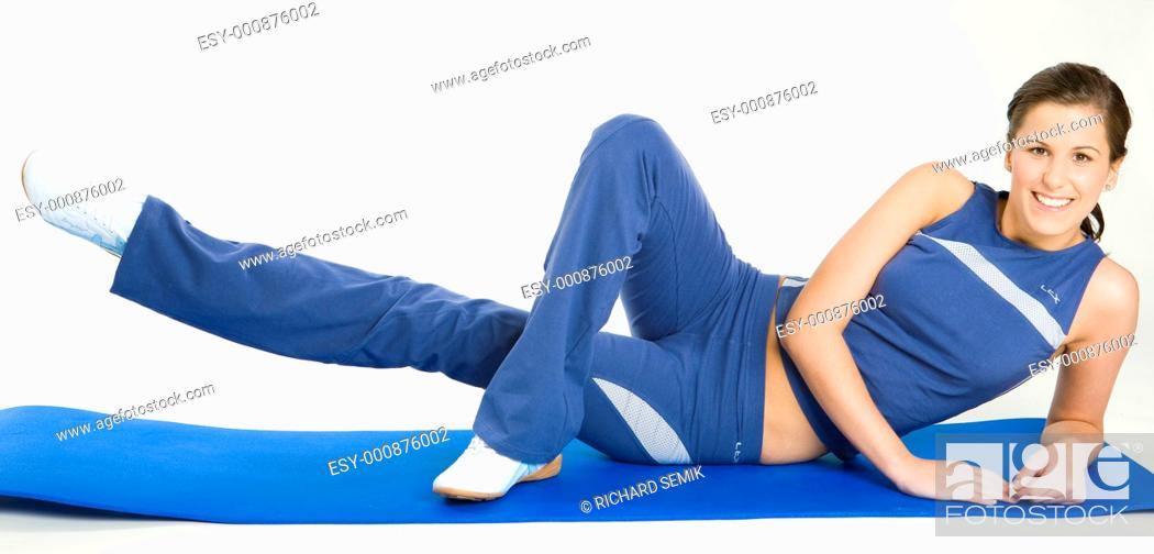 Stock Photo: exercising woman.
