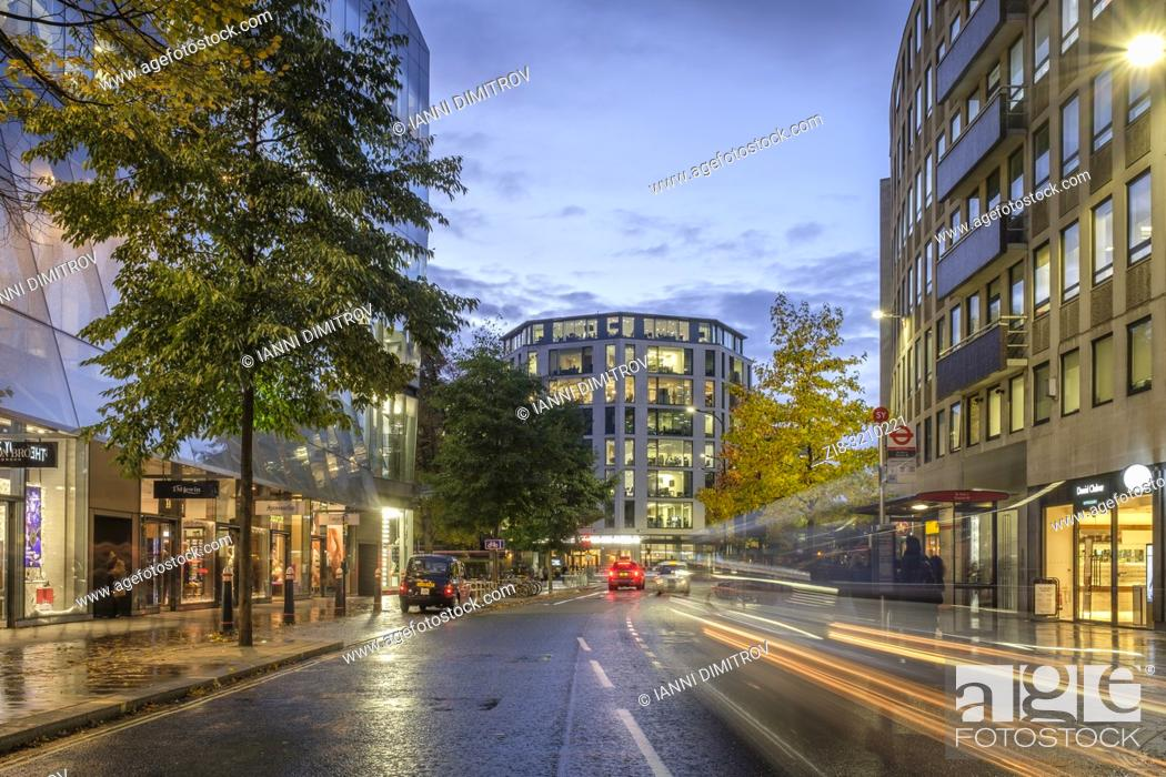 Stock Photo: England, London, Cheapside, One New Change- traffic trails at night.