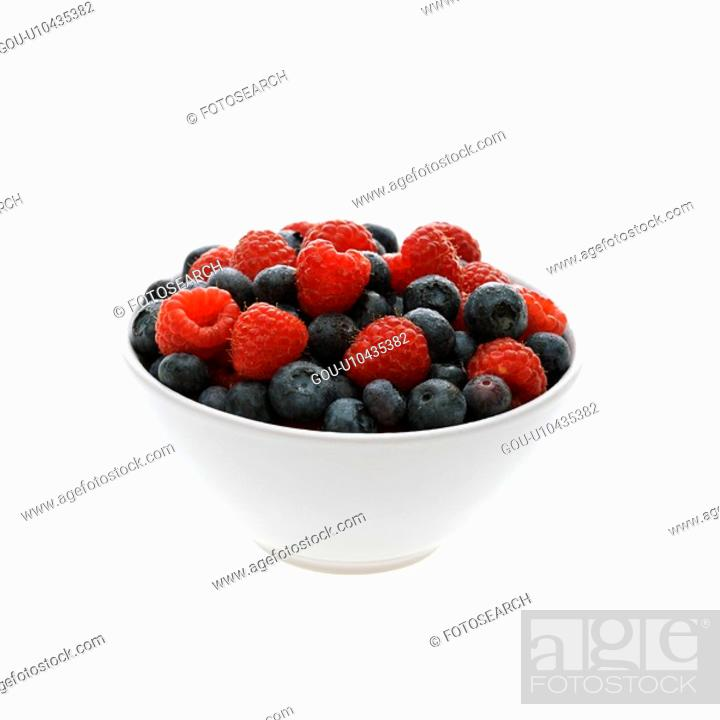 Stock Photo: Bowl of mixed blueberries and raspberries on white background.