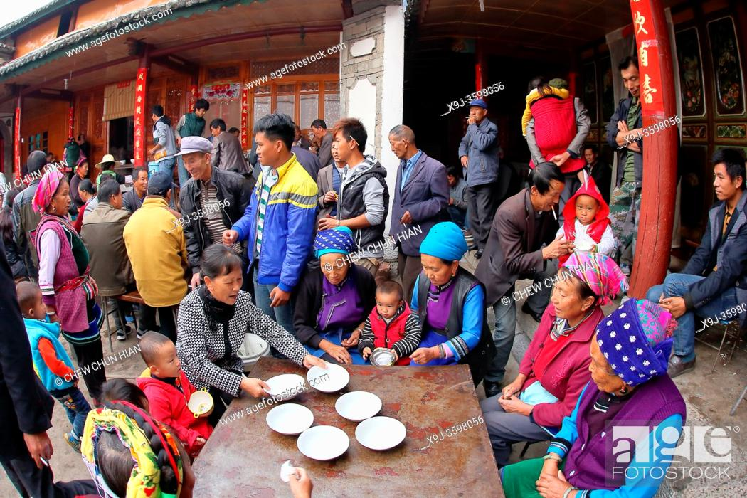 Stock Photo: Family and friends having lunch togather for some celebration in Bei people's village in Dali, yunnan province, china.