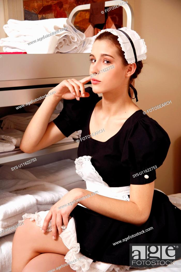 Stock Photo: Hotel maid taking a break.