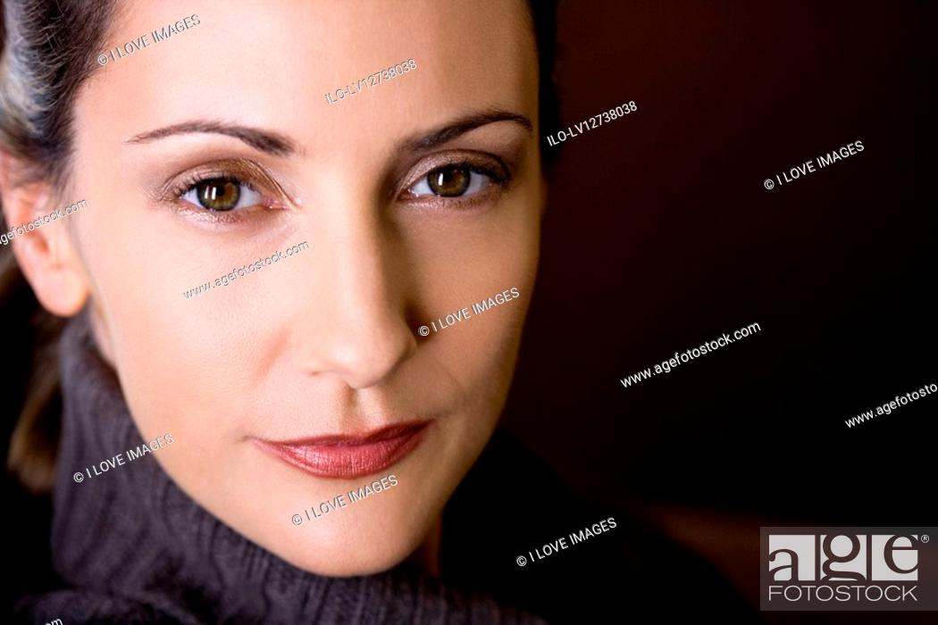 Stock Photo: Portrait of a mid adult woman, close-up.