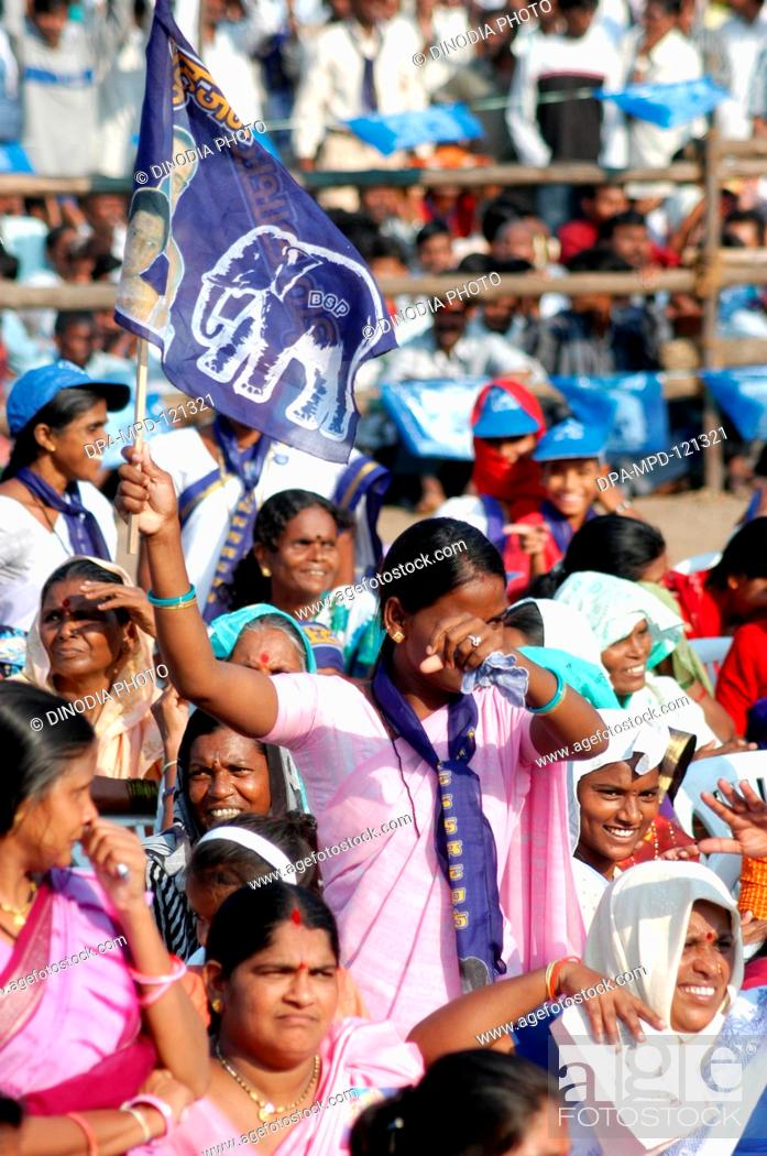 A women supporter of BSP standing with the flag of Bahujan